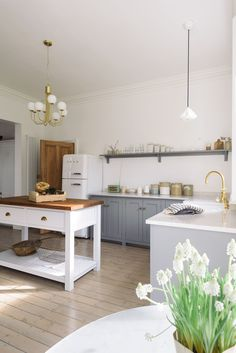 Grey and white open shelf kitchen.