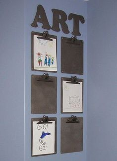 """Clipboards allow for a utilitarian look - but also look """"clean"""" and """"design-y"""" - Great trick for displaying kid art! From Sara Eizen - local Seattle mom and founder of Nest"""