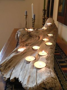 8 Easy DIY Wood Candle Holders for Some Rustic Warmth This Fall - Candles - Ideas of Candles - Driftwood comes in all sorts of interesting shapes and sizes which you can take advantage of by drilling tea light pockets into different levels of the wood. Driftwood Candle Holders, Rustic Candle Holders, Rustic Candles, Diy Candles, Driftwood Centerpiece, Candle Decorations, Beach Decorations, Candle Holder Decor, Fall Candles