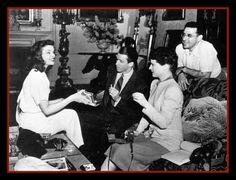 "candid shot taken on the set of ""The Philadelphia Story,""  w/ Hepburn, Stewart & Cukor."