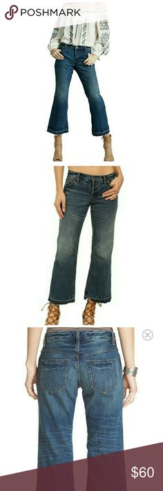 """Free People """"Chelsea"""" crop Jeans Dramatic sanding and lived-in fading bring eye-catching definition to trendy blue jeans cut with cropped, released kick-flare hems for a cool throwback-inspired finish. Raw unfinished hem. Color is Jacob-a darker wash  26"""" inseam; 21"""" leg opening; 9 1/2"""" front rise; 13"""" back rise (size 29) Size 8, Zip fly with button closure.Five-pocket style.100% cotton.Dry clean or machine wash cold, tumble dry low.By Free People; imported.t.b.d. Free People Jeans Flare…"""