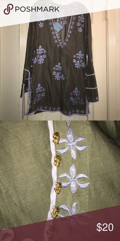 Olive cotton tunic/mini/swimwear cover-up. Olive cotton tunic/mini/swimwear cover-up with light blue embroidery. Bell sleeves with fabric ties, slit on sides with fabric ties. Gold skull buttons (decor rather than utility). Letarte Dresses Mini