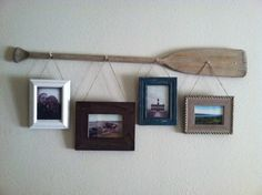 1. buy an old oar at a garage sale 2. screw it into the wall at 4 points 3. frame 4 of your favorite nautical pics 4.use hemp twine to hang your pics