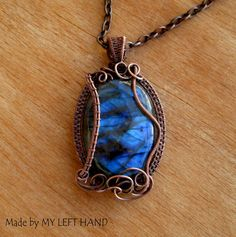 Labradorite Wire Wrap Necklace Copper Wire by MadeByMyLeftHand OOAK blue labradorite wire wrapped necklace. Antiqued copper wire wrap pendant on solid copper chain.  2 1/2 in (63 mm) High 1 3/8 in (36 mm) Wide