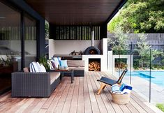 The outdoor room is set up so it's easy for Andrew and Colleen to kick back and relax while the kids play in the pool. Outdoor setting from Satara. Cushions from Pad Home Design Concept. Common ground: new Victorian family home