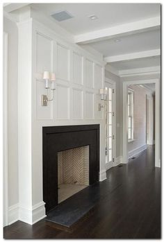 Chic living room boasts a wainscot trim illuminated by TT Double Sconces over a…. Chic living room boasts a wainscot trim illuminated by TT Double Sconces over a…. Farmhouse Fireplace, Home Fireplace, Fireplace Remodel, Living Room With Fireplace, Fireplace Surrounds, Fireplace Design, Fireplace Molding, Fireplace Ideas, Slate Fireplace Surround
