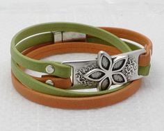 Full Bloom Arizona Wrap Bracelet & How-to make Video Tutorial   The Wrapped Double Riveted Arizona Leather Bracelet delivers a lot of design bang for your buck! This bracelet can be made for less than $20. The hot Arizona Leather colors pop against the sliver rivets and flower bracelet bar. The flower pattern clasp is the icing on the cake.   Click below to see the Video Tutorial on how to make this Bracelet: http://www.antelopebeads.com/Euro-Leather-Tutorials.html