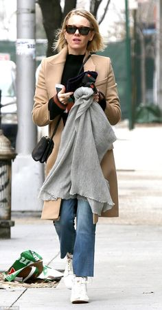 Got the chills! The actress went for several layers to keep warm, with her tan trenchcoat'...