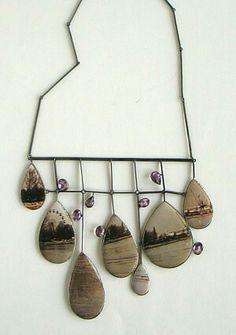 """""""Os Argonautas"""" - necklace by Bettina Speckner, 2010. Photos encased in enamel, silver, amethyst."""