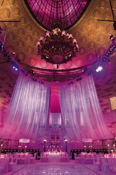 purple lighting, fabric draping, wedding reception
