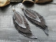 Black leather feather earrings. Extra long feather earrings. Large feather earrings. Bohemian earrings. Boho earrings. Black silver earrings. Materials: leather,silver plated metal. Color: black,silver. Length with hooks: 4.5 If you have any questions, please contact me. You can view more items in my shop: https://www.etsy.com/uk/shop/VelmaJewelry Shipping information: UK delivery 1-3 business days EU delivery 3-5 business days Everywhere Else delivery 5-10 busines...