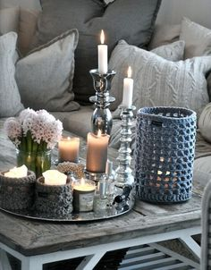 No pattern, but I'm thinking that the crocheted candle holder could be made from LB's Wool Stainless Steel (http://lbcollection.lionbrand.com/lbc/lbCollectionStainlessSteelWool.html) yarn and used with a candle in a glass jar or a battery operated candle. Would be easy to figure a pattern for. ~ Sheila