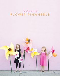 We don't know about you but we love any prop that is over-sized. Check out out adorable flower pinwheels on the blog