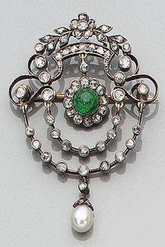 A diamond, emerald and pearl brooch, circa 1920.