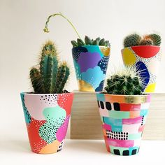 Our hand painted ceramic planters use bright colours and mark making to create u. Our hand painted ceramic planters use bright colours and mark making to create u. Pottery Painting, Ceramic Painting, Diy Painting, Painted Plant Pots, Painted Flower Pots, Painted Pebbles, Diy Recycling, Decoration Plante, Ceramic Planters
