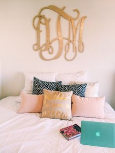 perfect preppy + cozy bedroom. Love the monogram and pillows!!