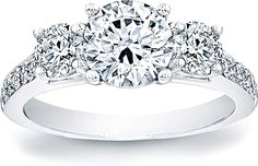 Three Stone Round Diamond Engagment Ring w/ Pave Band : This stylish three stone engagement ring features two prong-set round brilliant side diamonds, along with round brilliant pave accents on the band.This ring is designed to fit flush with just about any wedding band.