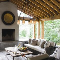 great covered outdoor living space w/ vaulted ceilings