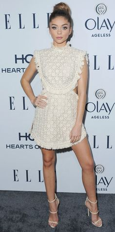 Sarah Hyland fused sweet and sexy on the red carpet in a neutral ruffled Zimmermann dress with cut-outs on each side, complete with white Giuseppe Zanotti sandals and Anita Ko rings.