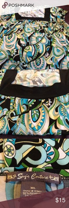 Colorful tunic style top This has been one of my favorite tops for awhile! Flattering square neck with light gathers at chest area and flowy tunic style. Cool and comfortable with turquoise, aqua, pale yellow, black and white color pattern. Short sleeves. suzie couture Tops Blouses