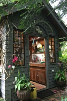 Rustic Garden Shed The dark exterior covered with vines gives this rustic shed a mysterious vibe.