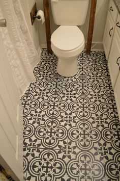 Love this...Chalk paint and stenciling on a linoleum bathroom floor