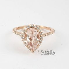 rose gold pear shaped halo diamond engagement ring... This is what I want. <3