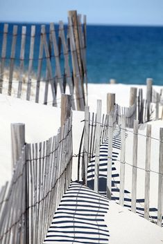 White sugar sand and the fence