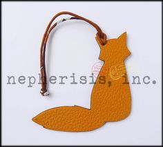 Hermes petit h leather ornament in fox design. Reversible. Great as a bag charm or wall decoration. New condition with Hermes box and ribbon.