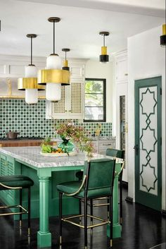 Green accents (kitchen chairs, custom cabinet­ry, and Moroccan tile) in designer Martyn Lawrence Bullard& kitchen pick up the colors of the leafy garden just beyond the glass doors. Modern Kitchen Lighting, Kitchen Lighting Fixtures, Dining Room Lighting, Light Fixtures, Modern Lamps, Home Design, Küchen Design, Layout Design, Interior Design
