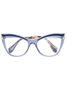 9ccf30b6edf Blue cat-eye glasses from Miu Miu Eyewear.