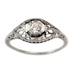 The Willa Diamond Vintage Engagement Ring, created in the 1950s, has a bold and unique presence that can't be ignored. Set in glowing 18k white gold, this piece features an Old Mine cut diamond, approximately .15ct, set amid ornate filigree. Cut in the 1890s, the diamond has J color and SI2 clarity, giving the piece a bright and beautiful sparkle.  This is a one-of-a-kind vintage ring, hand picked for its exquisite craftsmanship, super condition, and timeless aesthetics.   $648