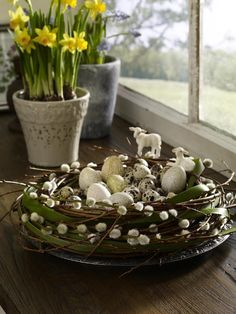 "56 Inspirational Craft Ideas For Easter.  I like the idea of using a twig wreath as the ""nest""."