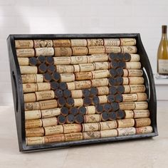All you need is a serving tray and corks (cut red wine corks to create letter and glue rest around it to fill). Best to do borders so you know the tray you use will not leave a space when done. Click through for more information. #ScotHibb