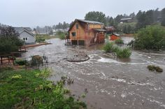 eptrail > A house with people still inside is completely surrounded by the Fish Creek on Thursday. Flooding closed roads and neighborhoods a...