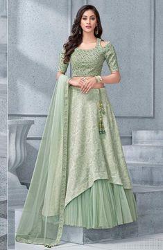 Buy Net And Lycra Pista Green Designer Lehenga Choli Online Indian Gowns Dresses, Indian Fashion Dresses, Dress Indian Style, Indian Designer Outfits, Indian Wear, Fashion Outfits, Lehenga Choli Online, Ghagra Choli, Net Lehenga