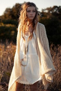 I like the messy hair white dress and big sweater