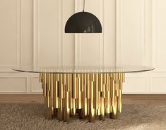 On Wanderlust dining table, a variety of heights and widths of the gold plated brass pipes carries the same artificial yet natural landscape into dining rooms. Underneath the extra clear glass table top, a selection of rare walnut root veneers are subtle touches that add further layers of color.