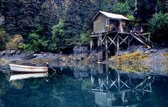 cabin next to a lake
