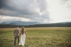 Lake Placid New York | Couples Portrait Walking Through Field | Photo by destination photographers Billie Jo and Jeremy Photography