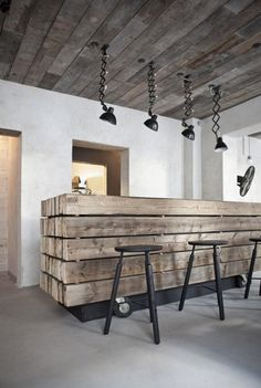 Vintage Industrial Style Restaurant | This is Höst restaurant and it has an incredible wooden counter top and vintage extendable wall lamps. | | Find more Vintage Industrial Style Interior Designs at www.vintageindustrialstyle.com