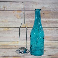 Hanging Bottle Candle Holder - Dark Blue Fantado https://www.amazon.com/dp/B00KEJJPJY/ref=cm_sw_r_pi_dp_vZvGxbFGRH7B6