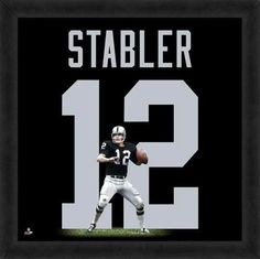 Featured is a Ken Stabler framed Oakland Raiders jersey photo. This photo has been professionally framed and is approximately 20x20. **Note: This photo is not signed.**