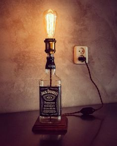 Bold & Super Fancy: a Jack Daniels Bottle Lamp with Edison Light Bulb.  Learn how to make a bottle lamp and shop all your supplies at www,ilikethatlamp.com (How To Make Bottle Lights)