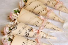 Sheet music wedding favors or aisle decorations or confetti cones Sheet Music Crafts, Music Paper, Wedding Favours, Wedding Bells, Wedding Events, Party Favors, Wedding Invitations, Candy Party, Wedding Locations