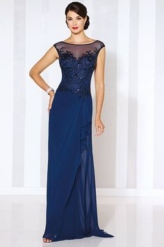 Chiffon sheath with cap sleeves, illusion bateau neckline, hand-beaded bodice, side draped skirt with cascading ruffle. Matching shawl included.Available Colors: Navy Blue, Silver, Dark ChampagneEnter to win dresses for mom, a David Tutera consult and more ►
