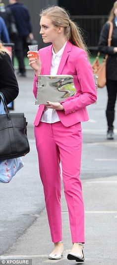 Chic: A beautifully dressed racegoer shows off her elegant pink suit and sensible silver flats