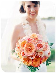 """The bridesmaids will carry bouquets of coral """"free spirit"""" garden roses, peachy """"Juliet garden roses"""", coral spray roses, peach ranunculus, camellia foliage and jasmine vine wrapped in champagne ribbon."""