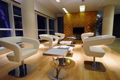 Shape chairs at Doha Bank, London. Hospitality, Interior, Design, Luxury, Furniture, UK, Style, Cream, Gold.