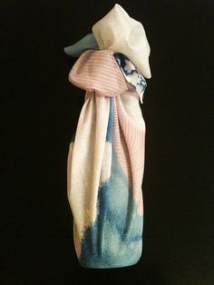 Furoshiki (風呂敷) - a wrapping cloth, used for decorating, wrapping or transporting objects. A wrapped bottle.